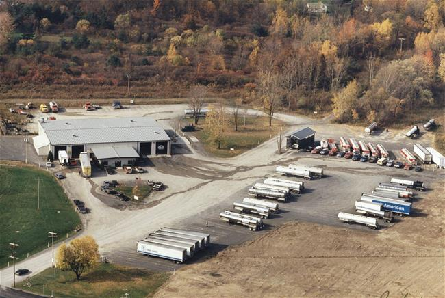 1991 - The business and property are expanding! The land is being cleared for additional trailer storage space, and the building will be added on to 3 more times before it is what we currently have.